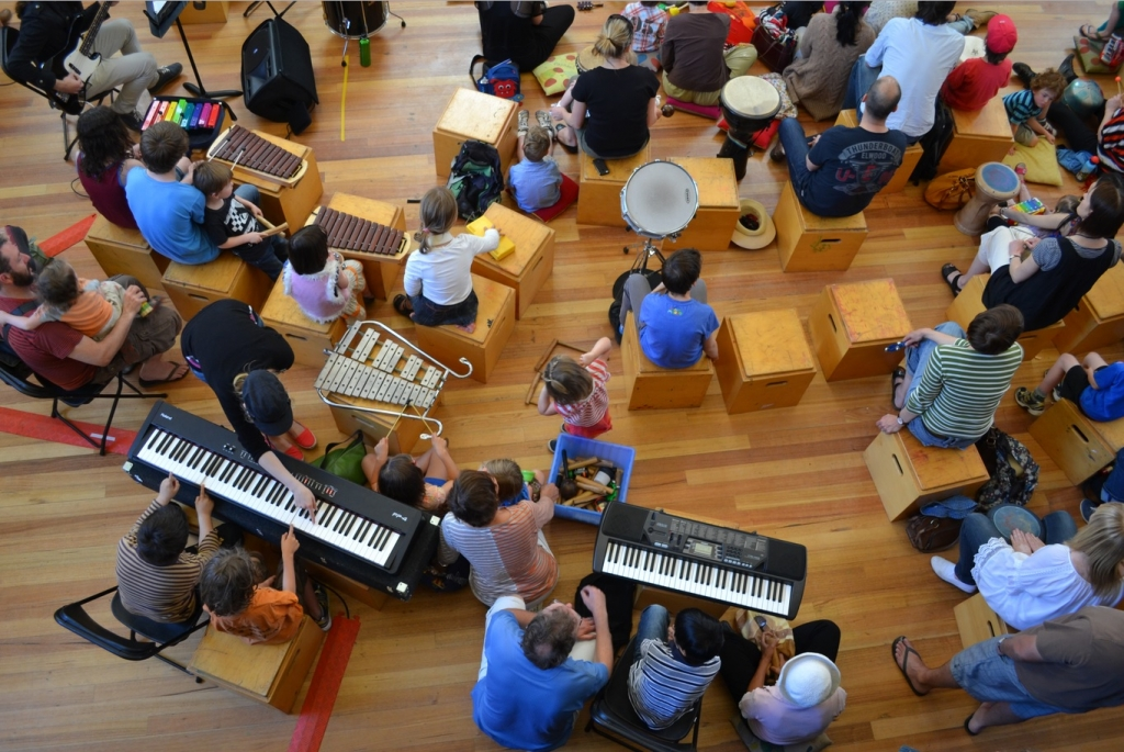 Birds eye view of group of individuals playing instruments